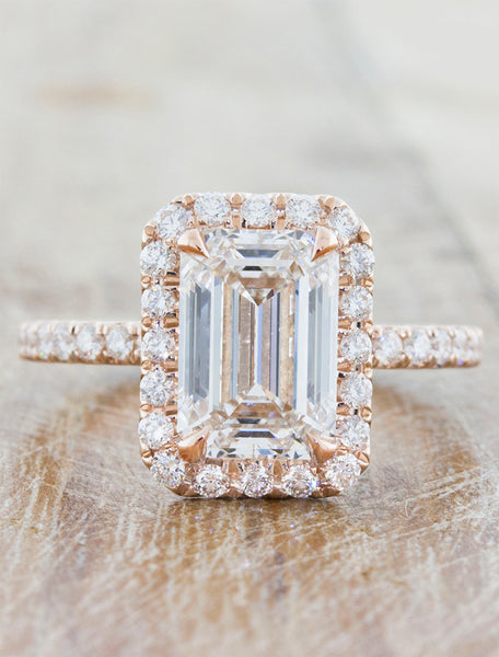Halo engagement ring caption:2.40ct. Emerald Cut Diamond 14k Rose Gold