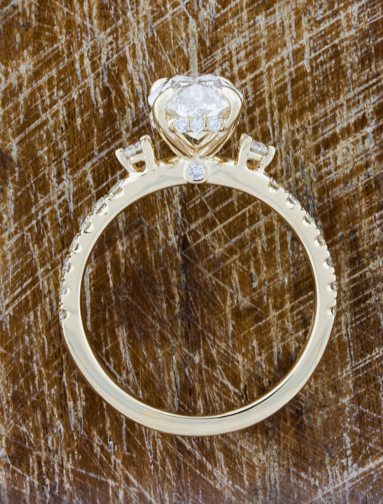 Oval Diamond Flanked by Side Stones in Pave Band