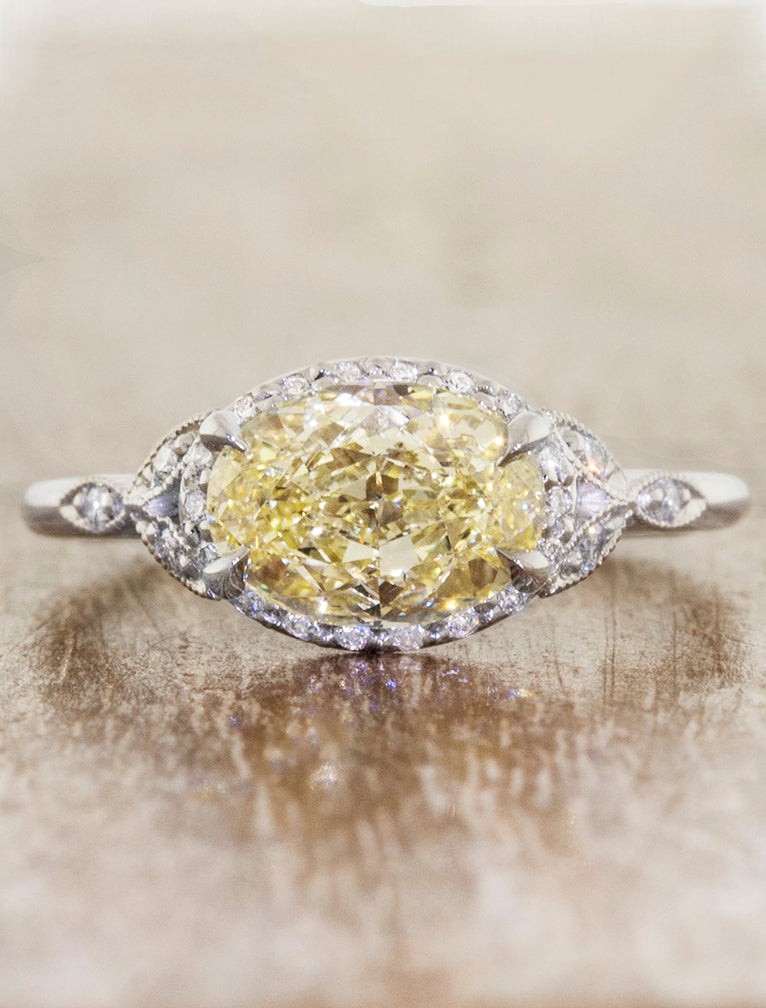 caption:Set in platinum with a 1.5ct yellow diamond, set horizontally