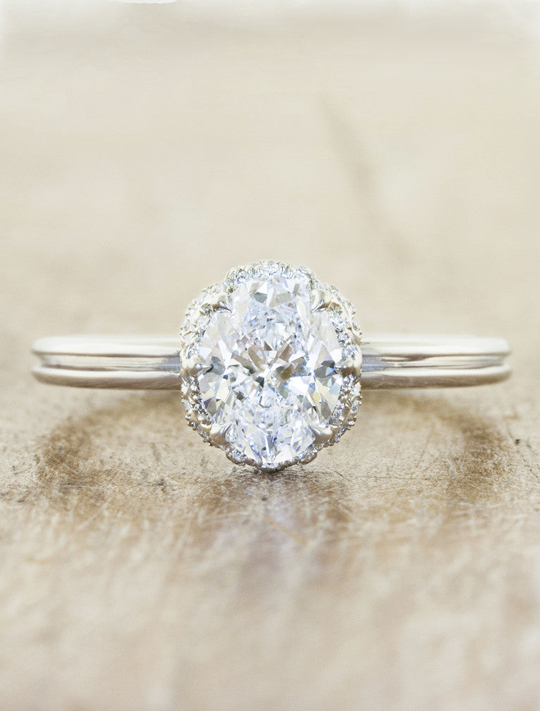Vintage inspired solitaire hidden halo;caption:1.25ct. Oval Diamond Platinum