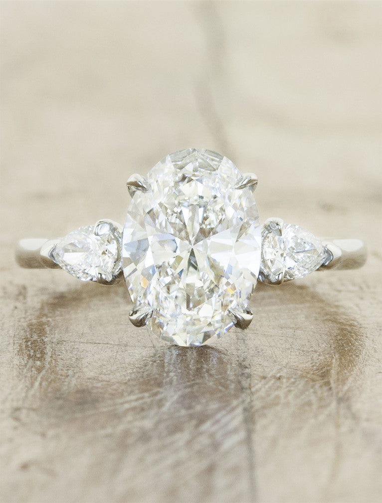 oval diamond three stone engagement ring, pear side diamonds