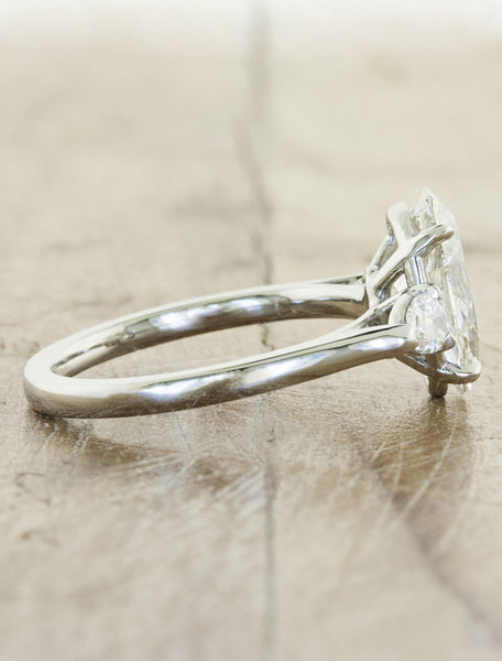 oval diamond three stone engagement ring, pear side diamonds - side view