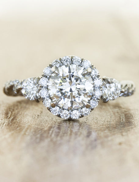 halo round diamond engagement 3-stone ring, rope band;caption:0.75ct. Round Diamond 14k White Gold