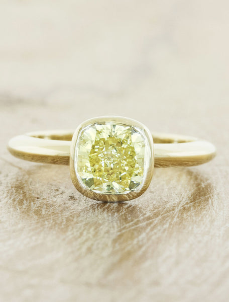 caption:Customized with a cushion cut yellow diamond