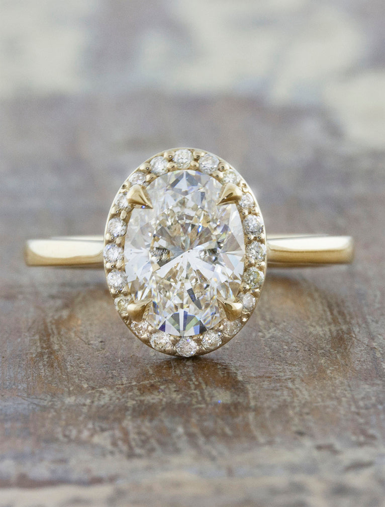 Stunning Oval Halo Diamond Engagement Ring. caption:Shown with 1.5ct center diamond