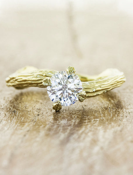 Nature inspired solitaire engagement ring caption:0.70ct. Round Diamond 18k Yellow Gold