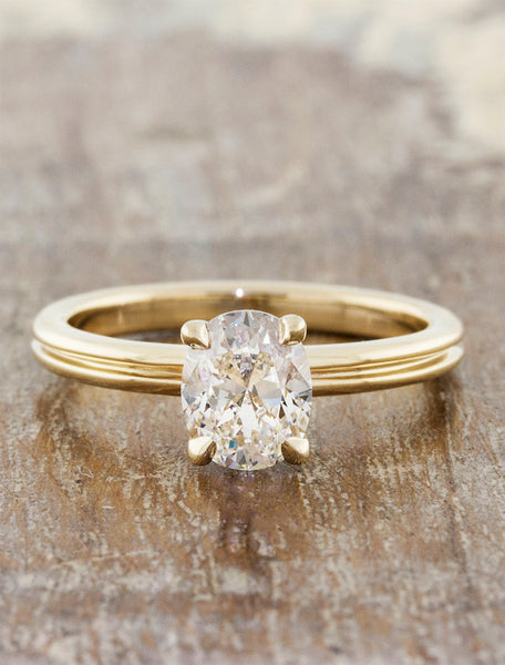 unique oval diamond engagement ring, double yellow gold band caption:0.65ct. Oval Diamond 14k Yellow Gold