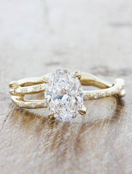 Nature inspired engagement ring leaf prongs;caption:1.25ct. Oval Diamond 14k Yellow Gold