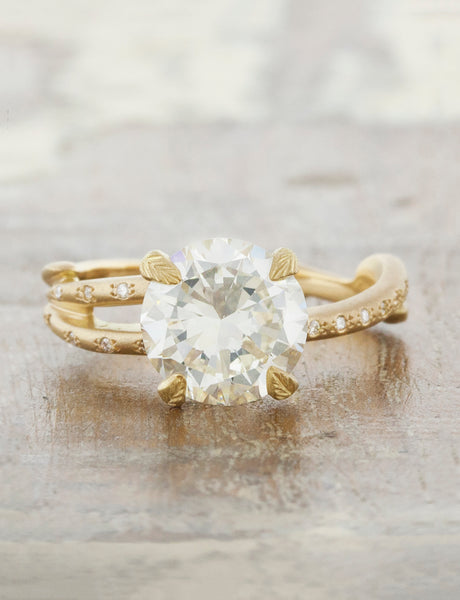 Nature inspired engagement ring leaf prongs;caption:1.70ct. Round Diamond 14k Yellow Gold