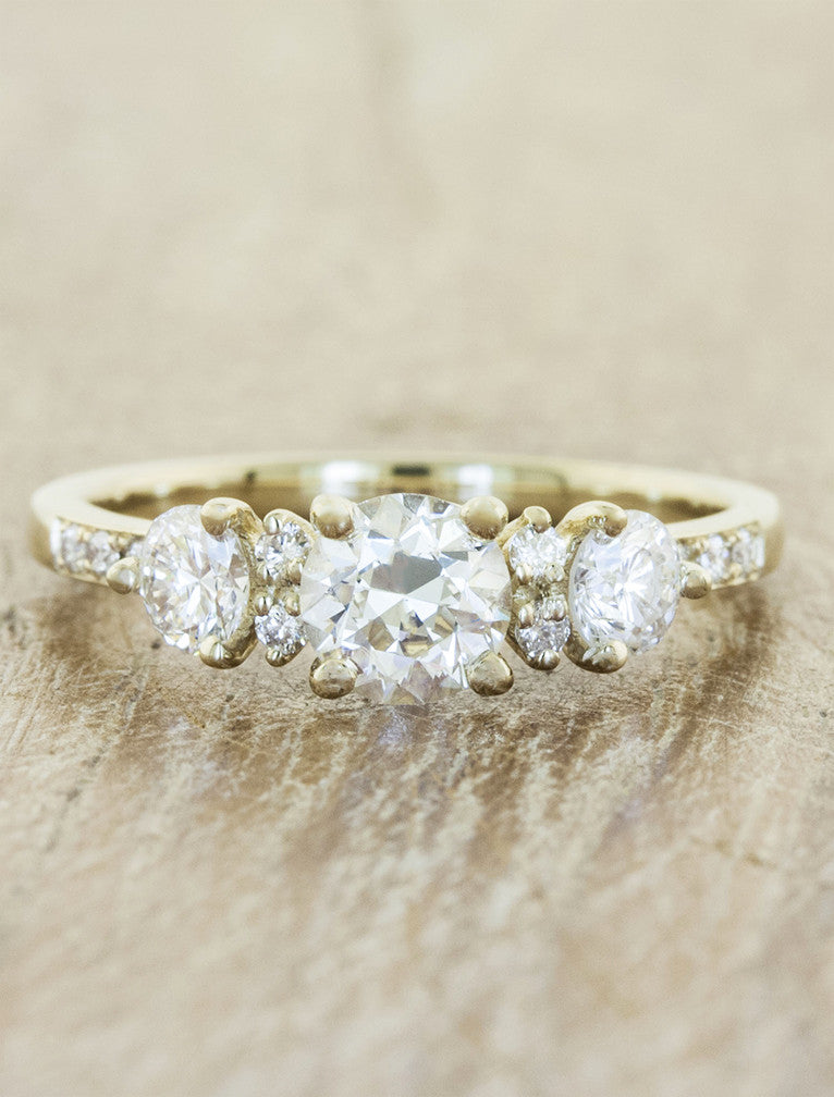 Vintage inspired 3 stone setting;caption:0.70ct. Round Diamond 14k Yellow Gold