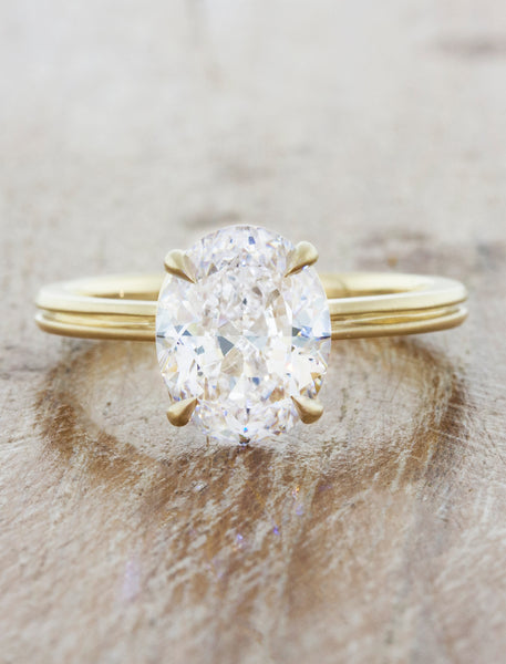 unique oval diamond engagement ring, double yellow gold band caption:1.75ct. Oval Diamond 14k Yellow Gold