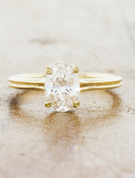 Double band solitaire;caption:1.10ct. Oval Diamond 14k Yellow Gold, customized with leaf detailing on the prongs