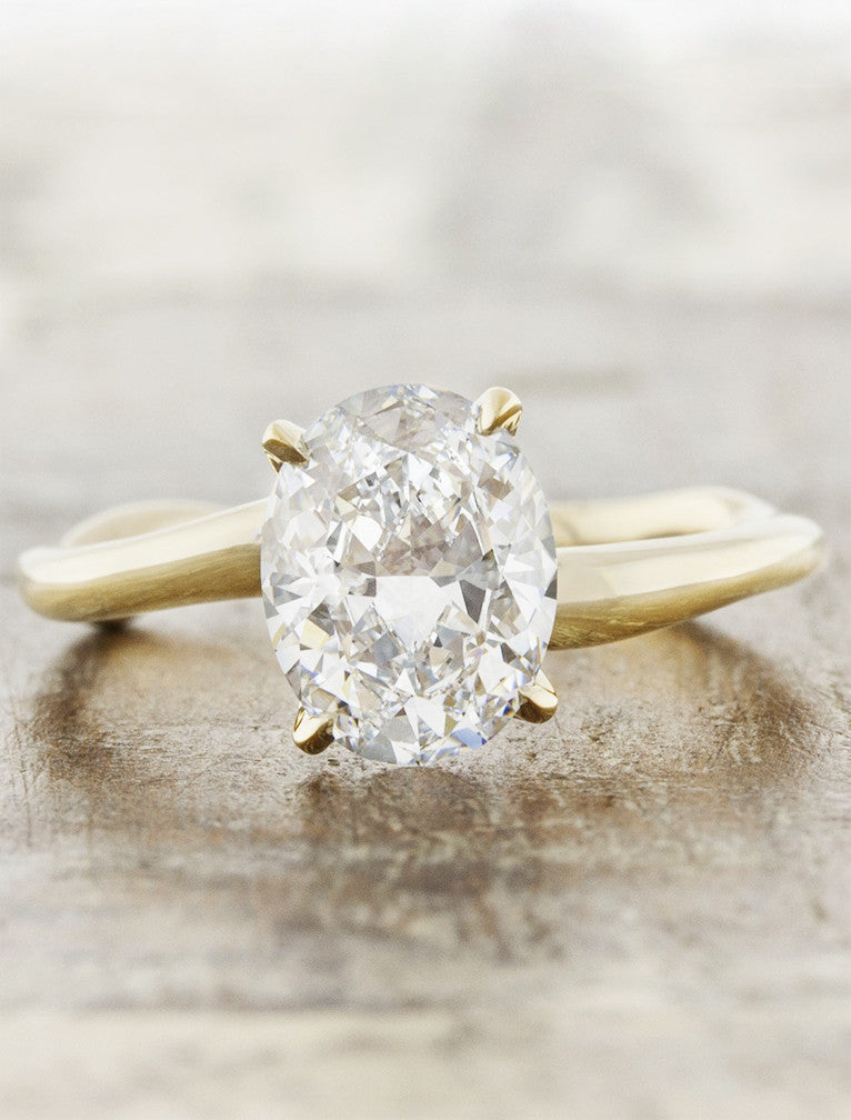 Nature inspired solitaire;caption:1.75ct. Oval Diamond 14k Yellow Gold