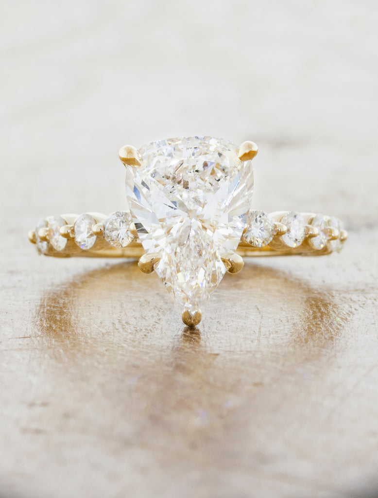 caption:Shown with a 3ct pear cut diamond