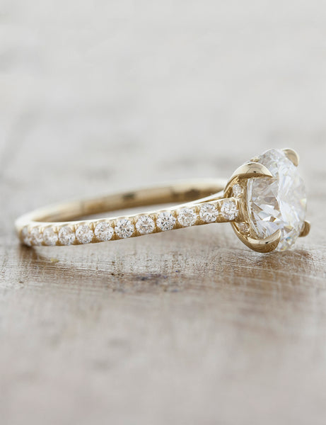 Solitaire with pave diamond band;caption:Pictured in 14k Yellow Gold