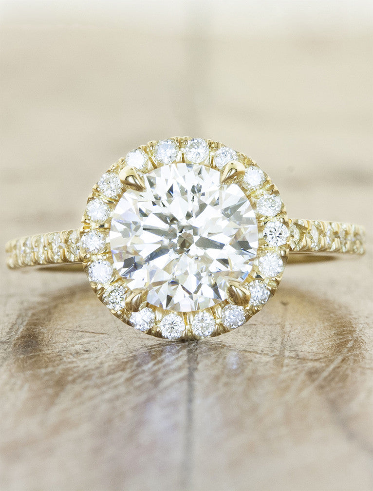 Round diamond halo engagement ring. caption:Shown with an 1.5ct diamond, set in 14k yellow gold