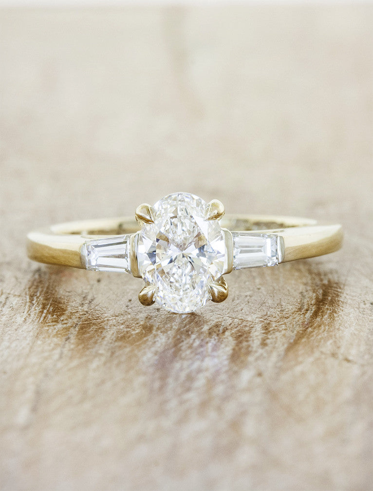 three stone oval diamond yellow gold ring, baguette accents