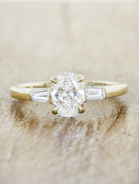 three stone oval diamond yellow gold ring, baguette accents;caption:Customized with an 1.00ct. Oval Diamond 14k Yellow Gold