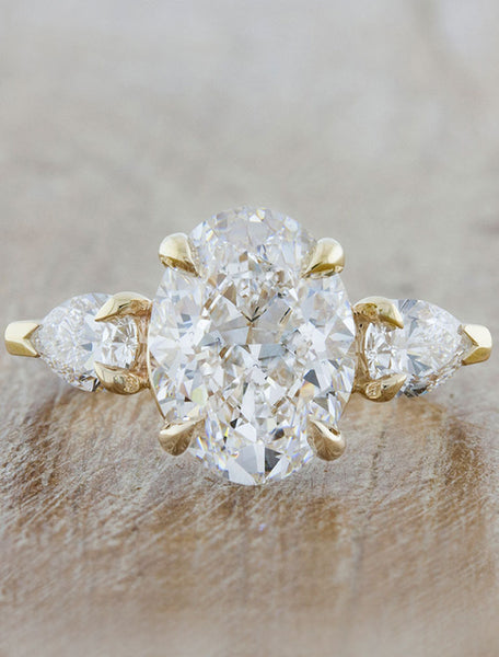 Three stone oval and pear;caption:3.00ct. Oval Diamond 14k Yellow Gold