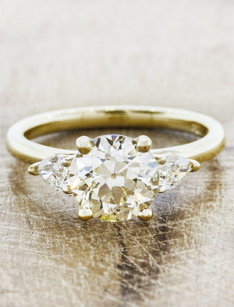 Oval diamond three stone engagement ring, pear side diamonds;caption:1.25ct. Old European Cut Diamond 14k Yellow Gold