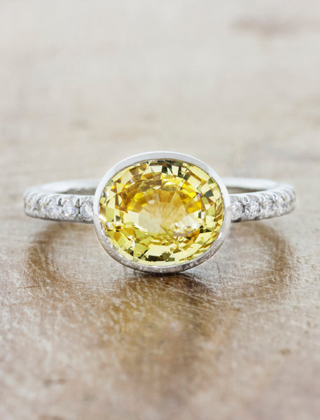 yellow oval sapphire in 2mm pave band