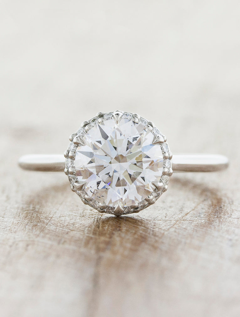 Subtle halo engagement ring;caption:2.00ct. Round Diamond Platinum