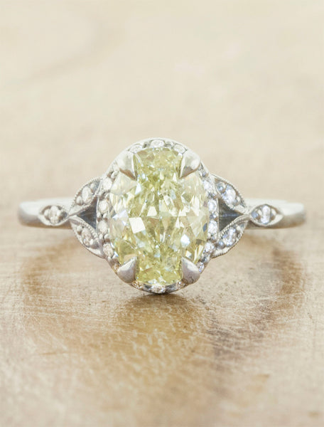 Vintage inspired halo engagement ring;caption:1.30ct. Oval Fancy Yellow Diamond Platinum