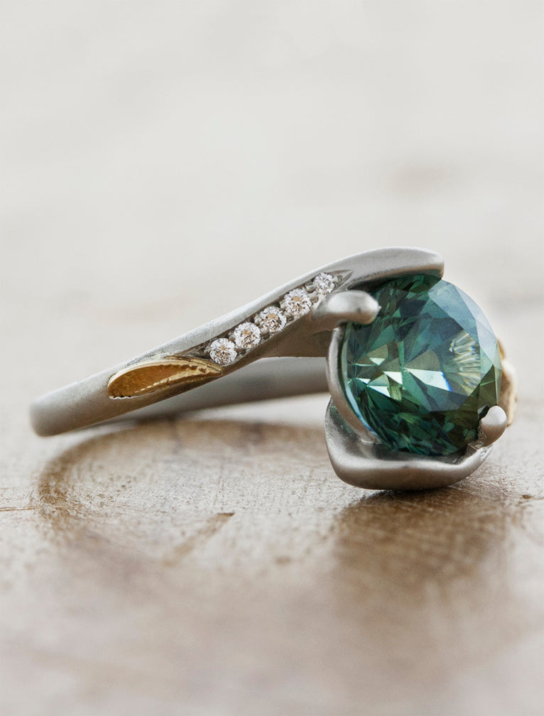 unique green sapphire solitaire engagement ring, asymmetrical
