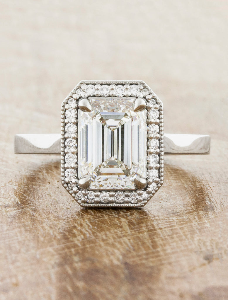 Vintage Inspired Halo Emerald Diamond Engagement Ring caption:2.12ct Emerald Cut Diamond in Platinum setting