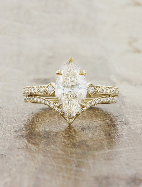 Vintage inspired engagement ring;caption:1.00ct. Marquise Diamond 14k Yellow Gold paired with Kia wedding band