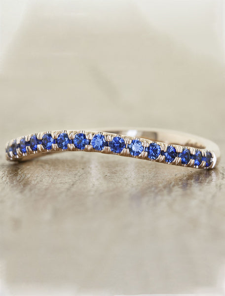 curved gemstone wedding band