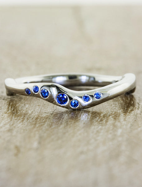 wavy wedding band with sapphires. caption:Customized with sapphires