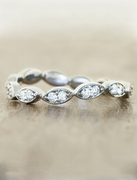 vintage-inspired curved wedding ring with diamonds