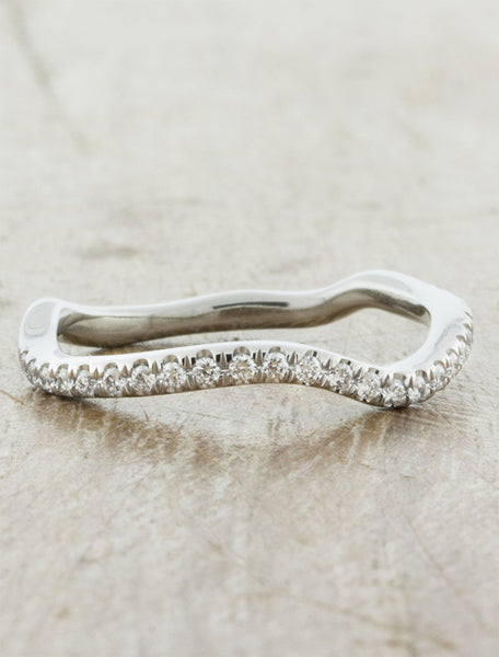 curved, wavy diamond studded wedding rings