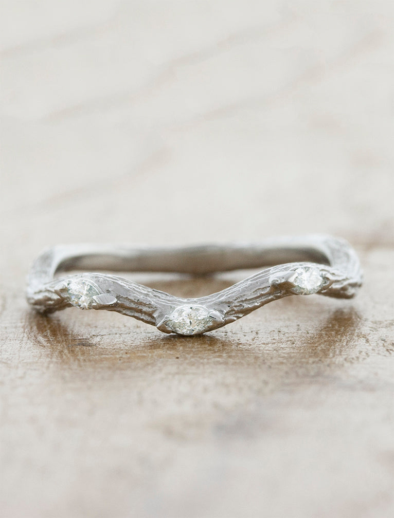 Nature inspired curved bark textured diamond wedding band with marquis diamond