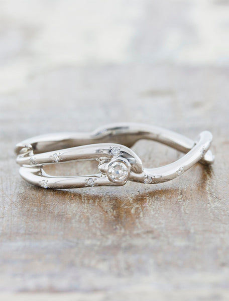 Nature inspired engagement ring;caption:Custom Version in Platinum with a 2.5mm Round Diamond