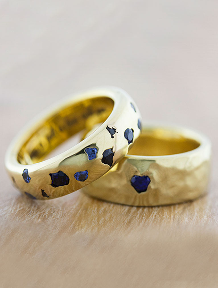matching set of wedding bands in yellow gold studded with sapphires