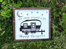 """We sleep around a lot"" Happy Campers sign"
