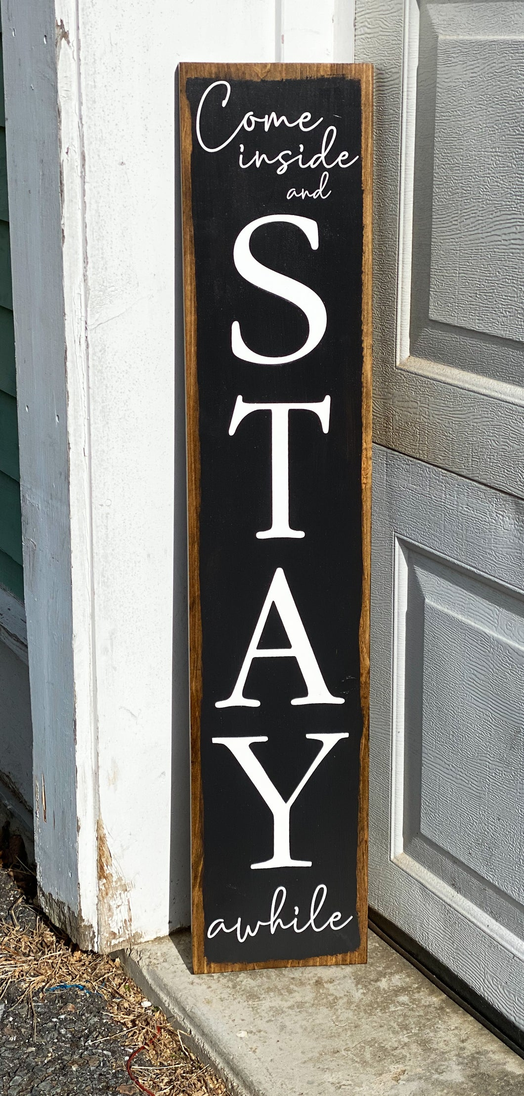"""Come inside and stay awhile"" porch sign"