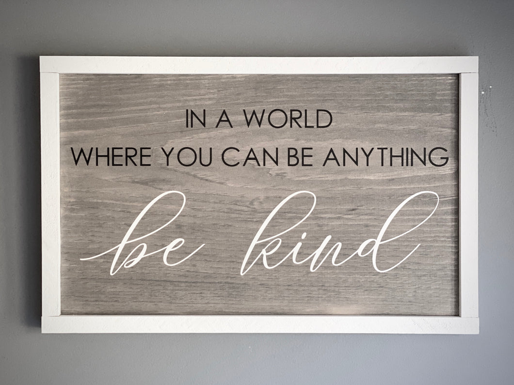 """In a world...Be kind"" quote sign"