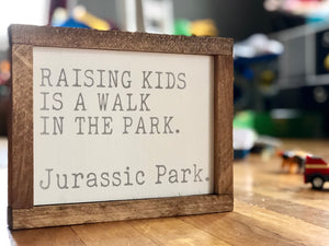 Raising kids.. Jurassic Park sign