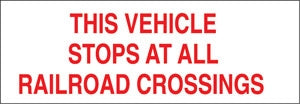 THIS VEHICLE STOPS AT ALL RAILROAD CROSSINGS