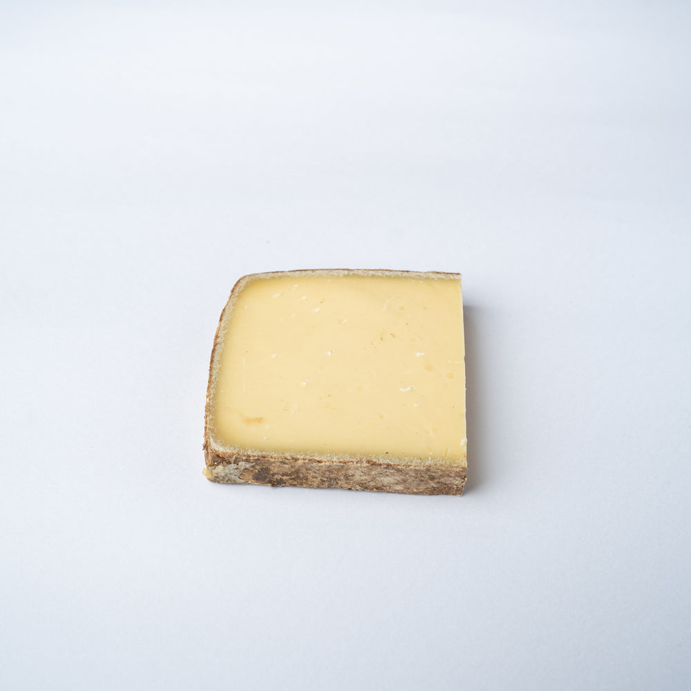 A 200g wedge of L'Etivaz cheese.