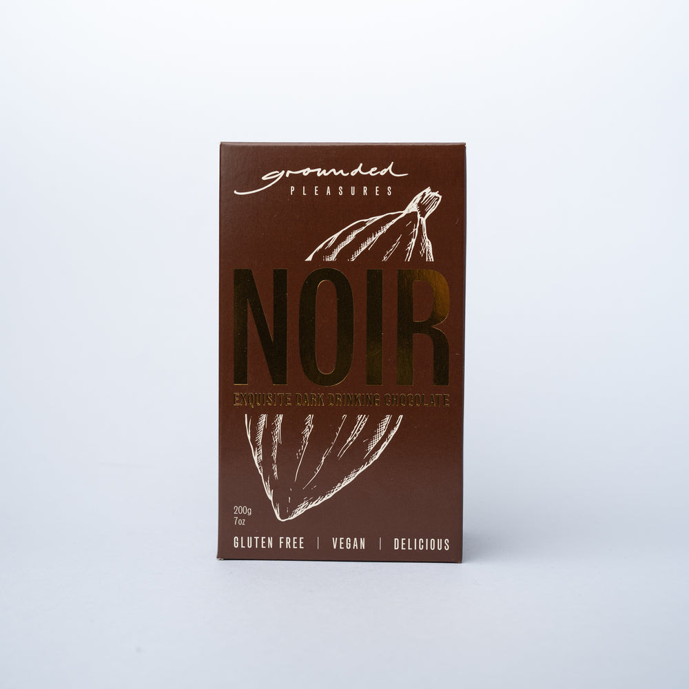 A box of Grounded Pleasures Drinking Chocolate Noir Exquisite Dark.