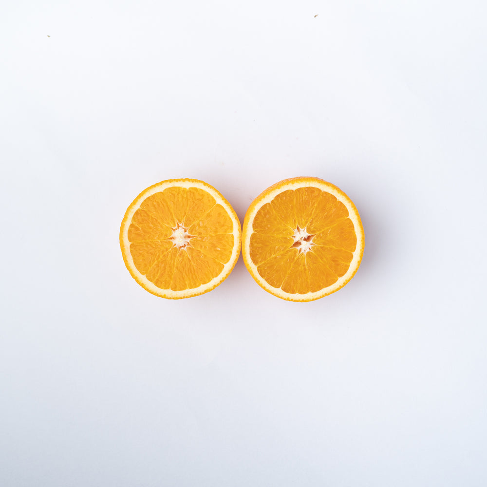An orange cut into two halves.