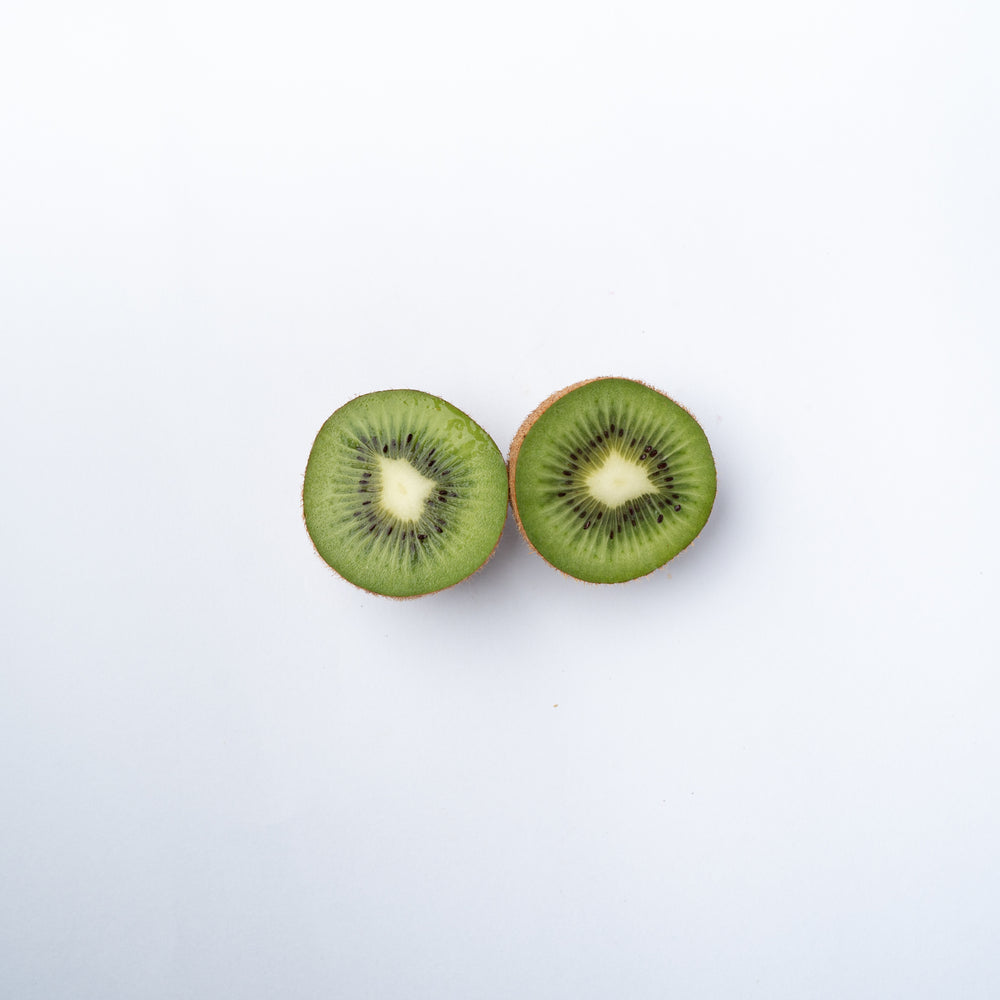 A kiwifruit cut into two halves.