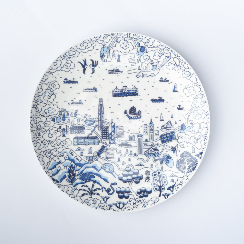 A plate with a blue and white design of iconic Hong Kong imagery.