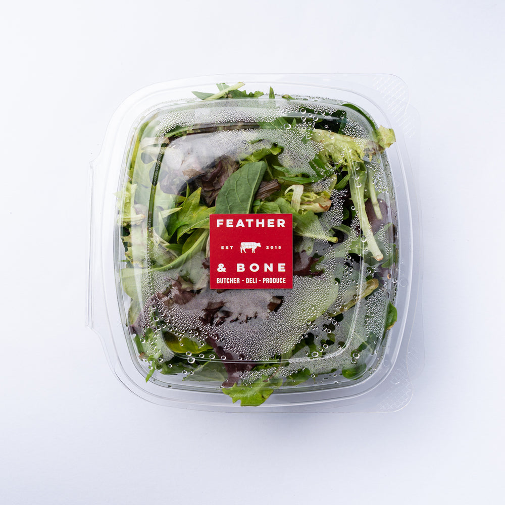A plastic box of Mixed Leaves with a red sticker.