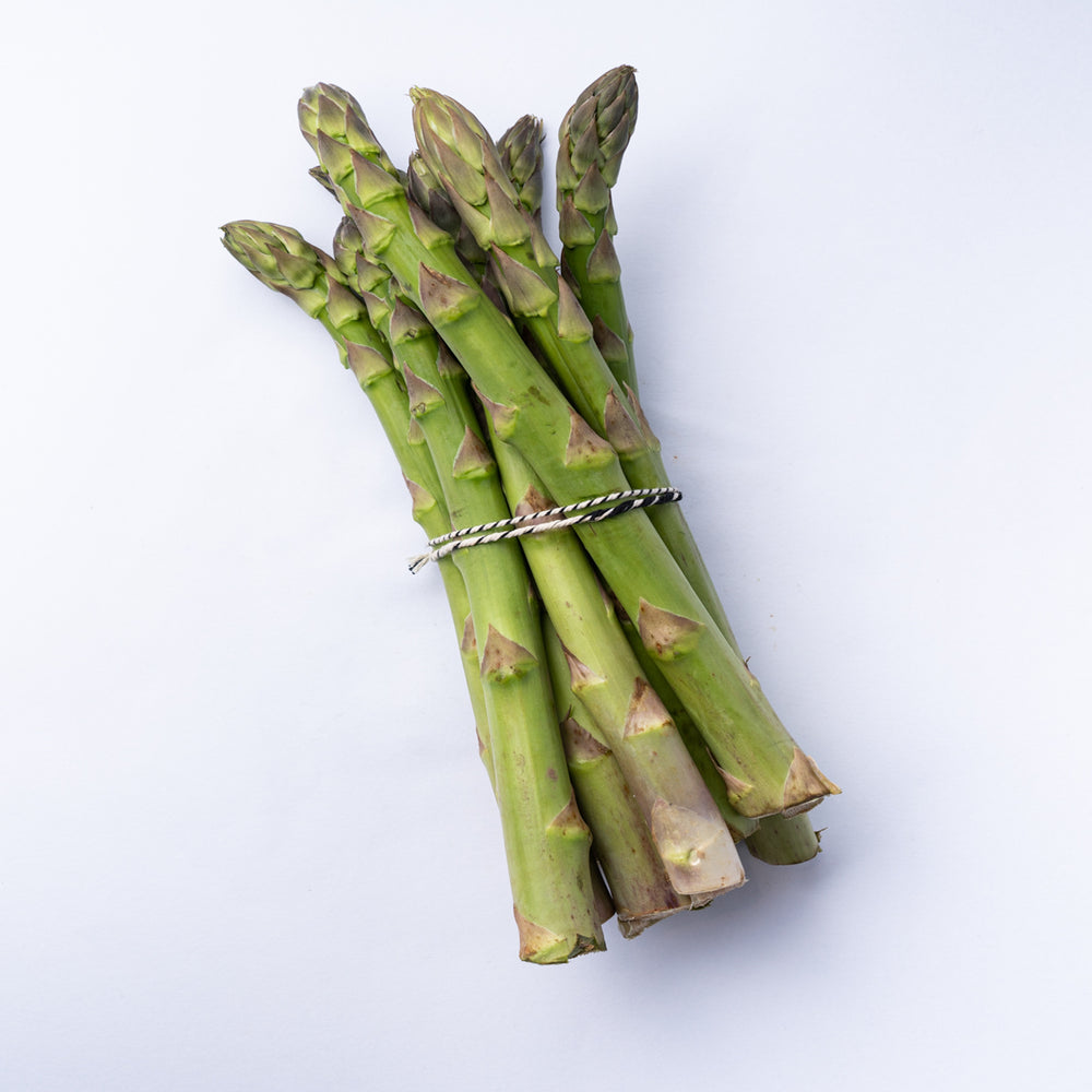 A 450g bunch of asparagus tied with rustic twine.