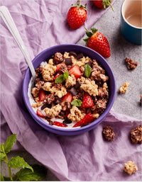 FUEL10K Chocolate Granola with berries in a bowl.